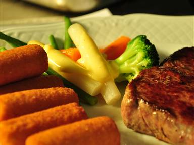 Meat with vegetables and croquettes