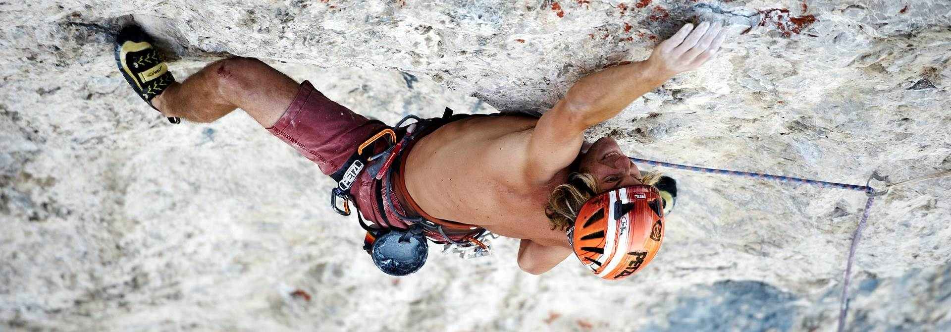 Climbers climb in rock face