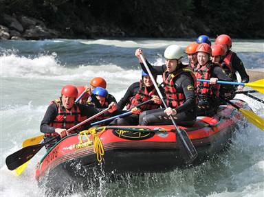 Group in an inflatable raft during white water rafting