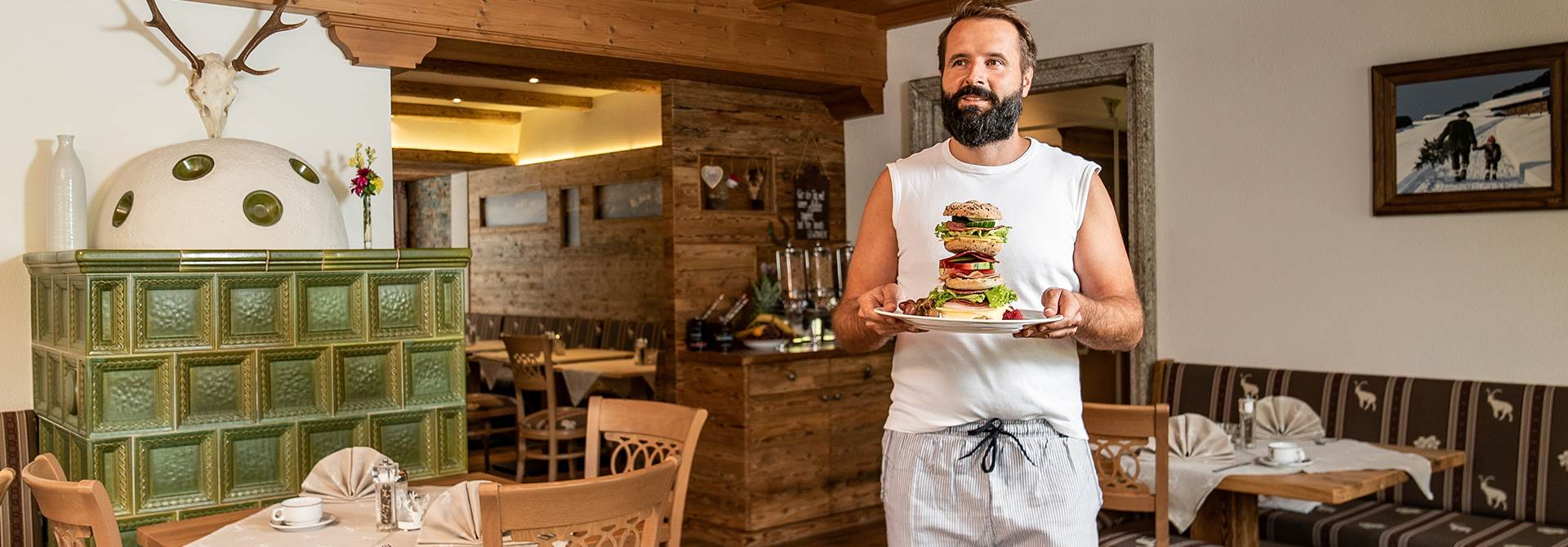 Man goes through inn with burger on plate